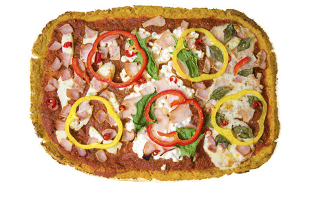 pizza crust: Top view of rectangular 3 in 1 oven baked cauliflower pizza crust topped with halloumi, cottage, mozzarella cheese, spinach, turkey, ham, peppers, chili, basil and tomato sauce. A healthy gluten free snack.