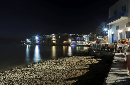 myconos: Little venice at night, aka Lefkandra, mikri Venetia a landmark of Chora in greek island Mykonos, Greece. Picturesque coffee shops and restaurants overlooking the aegean with colourful balconies hanging over sea. Stock Photo