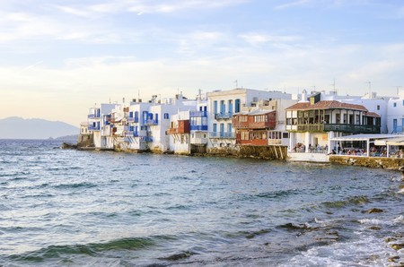 myconos: Little venice, aka Lefkandra, mikri Venetia a landmark of Chora in greek island Mykonos, Greece. Picturesque coffee shops and restaurants overlooking the aegean with colourful balconies hanging over the blue sea.