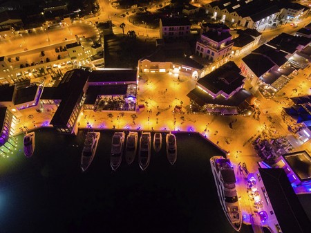 high end: Aerial night view of the beautiful Marina in Limassol city in Cyprus. A very modern, high end and newly developed area where yachts are moored and its perfect for a waterfront promenade. Stock Photo
