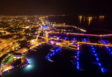 Aerial night view of the beautiful Marina in Limassol city in Cyprus. A very modern, high end and newly developed area where yachts are moored and its perfect for a waterfront promenade. Stock Photo