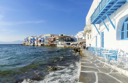 Little venice, aka Lefkandra, mikri Venetia a landmark of Chora in greek island Mykonos, Greece. Picturesque coffee shops and restaurants overlooking the aegean with colourful balconies hanging over the blue sea.