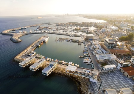 Aerial view of fishing boats docked at the Limassol old port (palio limani) in Cyprus, next to the Marina part of the ports authority. A view of the harbor, the mediterranean sea, the water, boat and fish nets and fishing equipment.