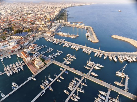 Aerial view of the beautiful Marina in Limassol city in Cyprus, the beach, boats, piers, villas, commercial area, old port (palio limani) and Molos. A very modern, high end and newly developed space where yachts are moored and its perfect for a waterfron