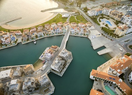 high end: Aerial view of the residential area of the beautiful Marina in Limassol city in Cyprus, the beach and villas. A very modern, high end and newly developed space where yachts are moored and its perfect for a waterfront promenade. Stock Photo