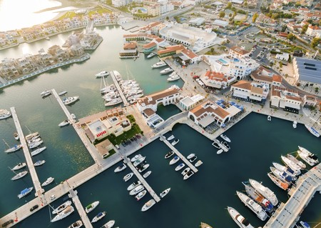 high end: Aerial view of the beautiful Marina in Limassol city in Cyprus, the beach, boats, piers, villas and commercial area. A very modern, high end and newly developed space where yachts are moored and its perfect for a waterfront promenade.