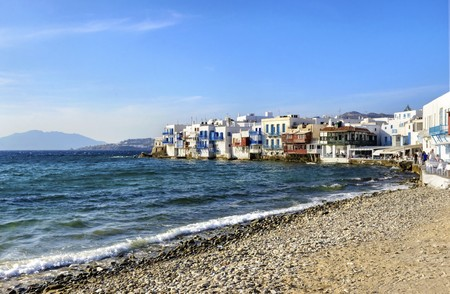 greek island: Little venice, aka Lefkandra, mikri Venetia a landmark of Chora in greek island Mykonos, Greece. Picturesque coffee shops and restaurants overlooking the aegean with colourful balconies hanging over the blue sea.