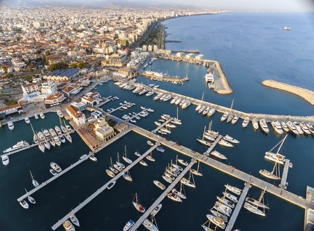 old port: Aerial view of the beautiful Marina in Limassol city in Cyprus, the beach, boats, piers, villas, commercial area, old port (palio limani) and Molos. A very modern, high end and newly developed space where yachts are moored and its perfect for a waterfron