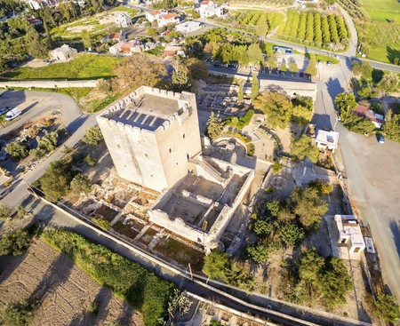 constitutes: Aerial view of the medieval castle of Kolossi. It is situated in the south of Cyprus, in Limassol. The castle dates back to the crusades and it constitutes a landmark of the area.