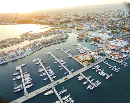colonade: Aerial view of the beautiful Marina in Limassol city in Cyprus, the beach, boats, piers, villas and commercial area. A very modern, high end and newly developed space where yachts are moored and its perfect for a waterfront promenade.