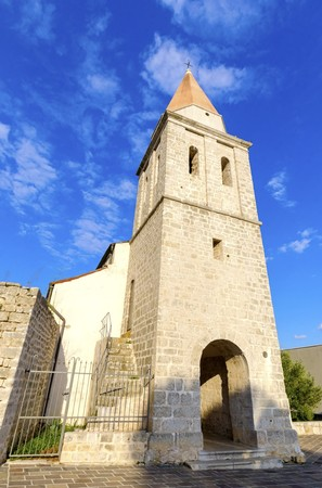 The pyramidal tower of the Church of our Lady of Health, a romanesque cathedral formerly named St Michael the archangel, basilica at the Square of the The Glagolitic housed monasteries on Krk island, in Croatia.
