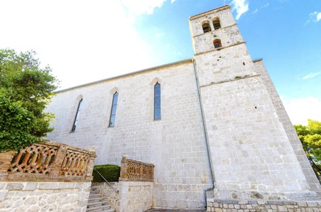 The bell tower of the gothic Church and monastery of St Francis, a Franciscan cathedral of the renaissance period with a quadratic roof, in the Glagolithic square on the island of Krk, in Croatia. Stock Photo