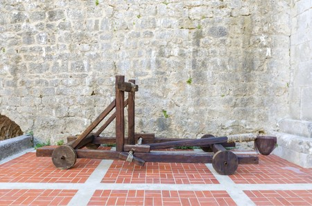 The interior of the Frankopan Castle, at Kamplin square in Krk, Croatia - Frankopanski Kastel, part of the medieval city walls. View of the courtroom, and wooden catapult inside the walls Editorial