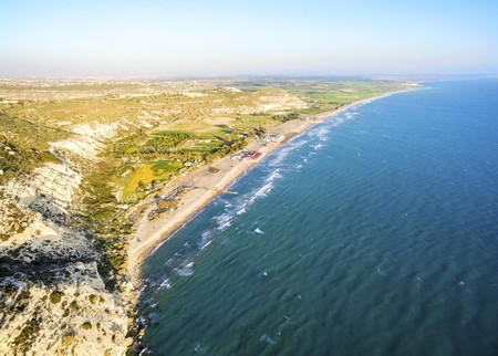 Aerial view of the arcaeological site of the ancient city of Kourio which is located in the district of Limassol, Cyprus. A view of the ancient theatre and the beach from the hill. Stock Photo