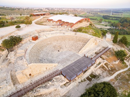 Aerial view of the arcaeological site of the ancient city of Kourio which is located in the district of Limassol, Cyprus. A view from the top of the greek roman theatre forming a semicircle, the beach and fields. Stock Photo