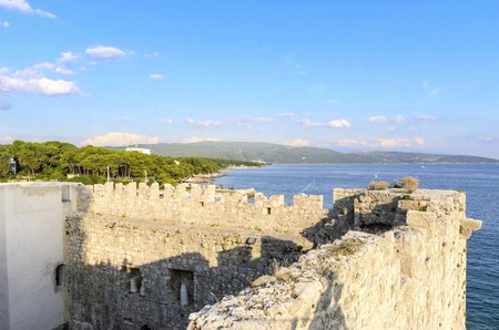 The interior of the Frankopan Castle, at Kamplin square in Krk, Croatia - Frankopanski Kastel, part of the medieval city walls. View of the archer loop holes and sea port of the island