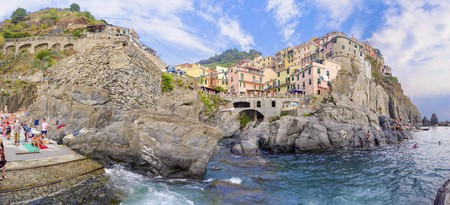 Manarola town, Riomaggiore, La Spezia province, Liguria, northern Italy. View of the colourful houses on surrounding hills, sea shore, balconies and windows. Part of the Cinque Terre National Park