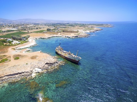 sinking: Aerial view of the abandoned ship wreck EDRO III in Pegeia, Paphos, Cyprus. The rusty shipwreck is stranded on the Peyia rocks at the kantarkastoi sea caves near Coral Bay in Pafos, standing at an angle near the shore. Stock Photo