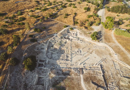 Aerial view of Amathounta ruins and columns at ancient greek roman archaeological site at Agios Tychonas, Limassol, Cyprus. Amathus royal city remains from above by Mediterranean sea.