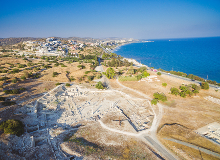 Aerial view of Amathounta ruins and columns at ancient greek roman archaeological site at Agios Tychonas, Limassol, Cyprus. Amathus royal city remains and coastal road in Mediterranean sea.