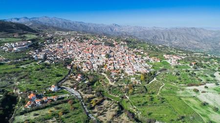 Aerial bird eye view of famous landmark tourist destination valley Pano Lefkara village, Larnaca, Cyprus. Ceramic tiled house roofs, greek orthodox church at south troodos hills, kionia, from above. Banco de Imagens