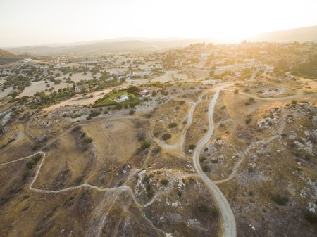 Aerial birds eye view of UNESCO world heritage site Choirokoitia, Larnaca, Cyprus. View of Khirokoitia, a prehistoric ancient neolithic archaelogical settlement with round houses, from above.