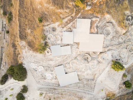 View of Khirokoitia, a prehistoric ancient neolithic archaelogical settlement with round houses, from above. Banco de Imagens