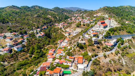 Aerial view of Kyperounda village on Madari, Troodos mountain, Limassol, Cyprus. Bird eye view of traditional ceramic tiled roof houses, countryside, valley and church from above. Editorial