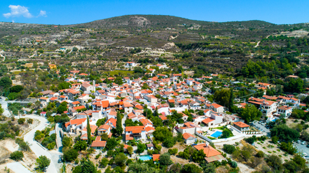 Aerial Lania (Laneia) wine village, Limassol, Cyprus. Birds eye view of traditional Mediterranean, picturesque alleys, red ceramic roof tile houses, vineyards, church and entrance. Editorial