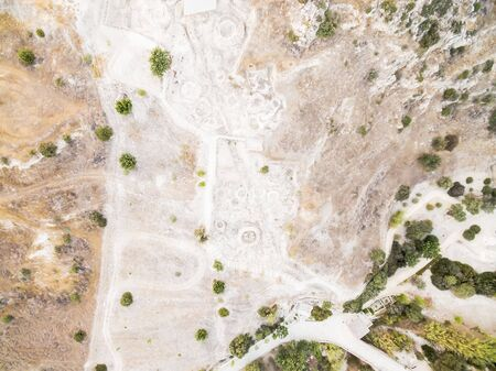 Aerial bird's eye view of Choirokoitia, Larnaca, Cyprus. View of Khirokoitia, a prehistoric ancient neolithic archaelogical settlement with round houses, from above. Foto de archivo - 150112975