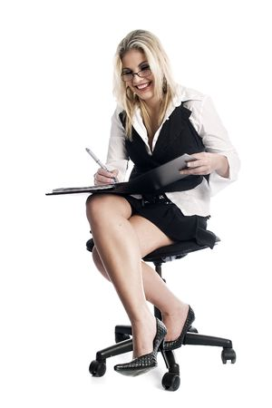 Girl on chair taking notes photo