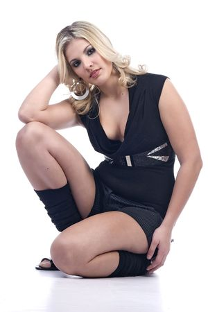Blond girl crouching in cute outfit photo