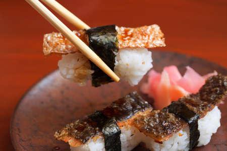 Picking salmon skin sushi