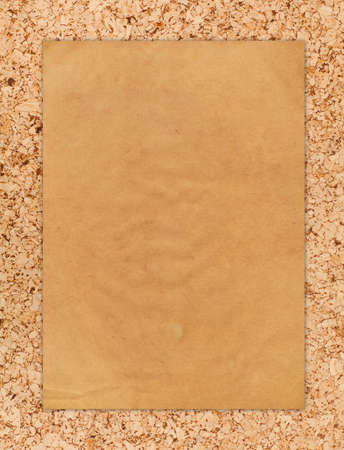 Vintage paper on corkboard Stock Photo