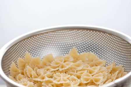 bow pasta in strainer