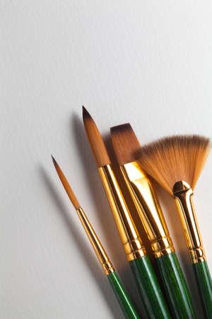 Brushes on new art paper Stock Photo