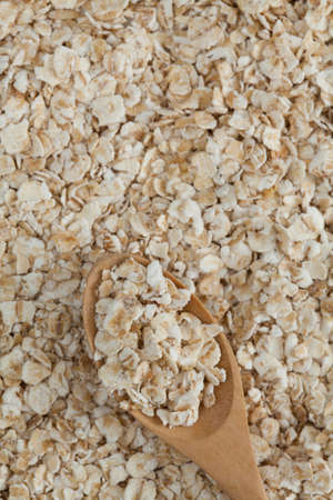 oatmeal on wooden spoon photo
