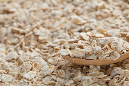 oatmeal on wooden spoon Stock Photo