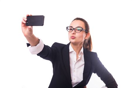 telecommuting: I love selfie! Portrait of a happy business lady blinking her eye while taking selfie with glasses