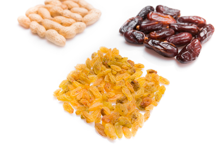 shvat: Peanuts, raisins and dried halawi  isolated on white background