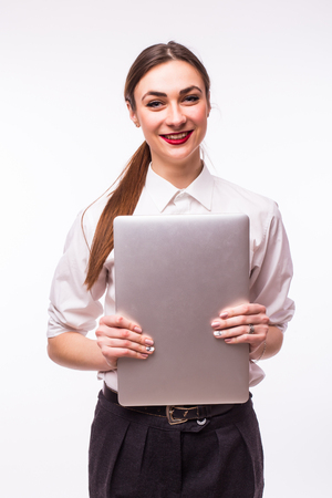yuppie: Smiling young  student girl with closed laptop against white background