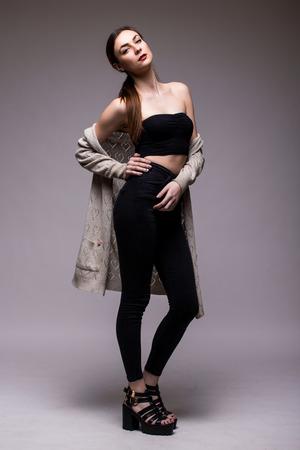 full shot: Full-length portrait young elegant woman in black clothes. Fashion studio shot Stock Photo