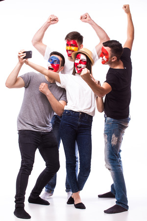 Group of football fans their national team: Spain, Czech Republic, Turkey, Croatia take selfie photo on white background. European football fans concept.