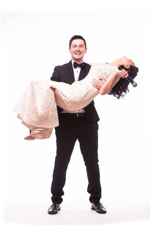 the showman: The Showman and showwoman. Young elegant man  with woman in hands against white background. Showman concept. Stock Photo