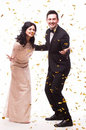 showman: The Showman and showwoman. Young elegant man  and woman holding microphone against white background. Showman concept. Stock Photo