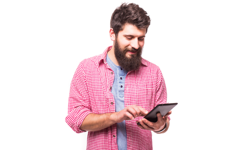 concentrated: concentrated bearded hipster  man  with digital tablet on white background Stock Photo