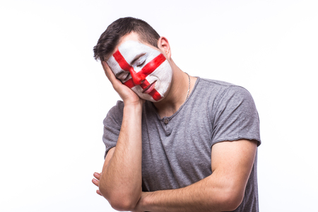 englishman: Unhappy and Failure of goal or lose game emotions of  Englishman football fan in game supporting of England national team on white background. European football fans concept.