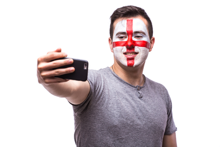 englishman: Selfie on phone of Englishman football fans in game supporting of England national teams on white background. European football fans concept. Stock Photo