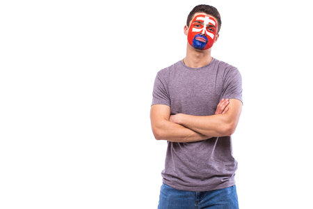 Slovak football fan in game support of Slovakia national team on white background. European football fans concept.
