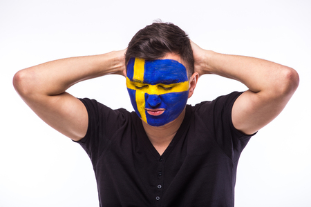 swede: Unhappy and Failure of goal or lose game emotions of  Swede football fan in game supporting of Sweden national team on white background. European football fans concept.